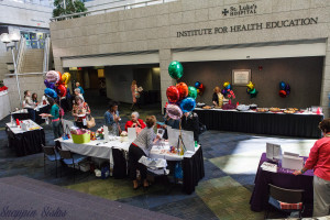 Vendors set up tables in atrium.