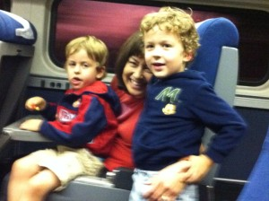 naomi with boys on train