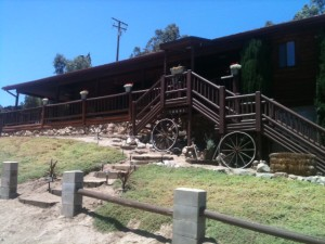 """Log cabin at the """"Paws for Effect"""" ranch."""