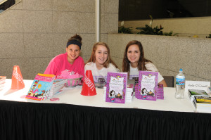 Teen volunteers at the author table.